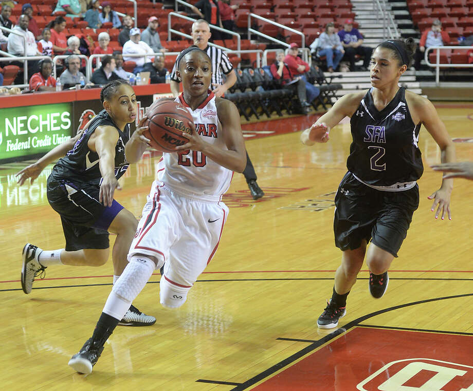 Lamar Lady Cardinals senior guard JaMeisha Edwards has proven to be the epitome of a student-athlete as she's excelled both academically and athletically in her career.  Lamar's JaMeisha Edwards makes her way into the paint after getting past Stephen F. Austin's Paulletta Powell (left) and Taylor Ross during Thursday night's game at the Montagne Center.  Photo taken Thursday, January 22, 2015  Kim Brent/The Enterprise     Manditory Credit, No Sales, Mags Out, TV Out, Web: AP Members only Photo: Kim Brent / Beaumont Enterprise