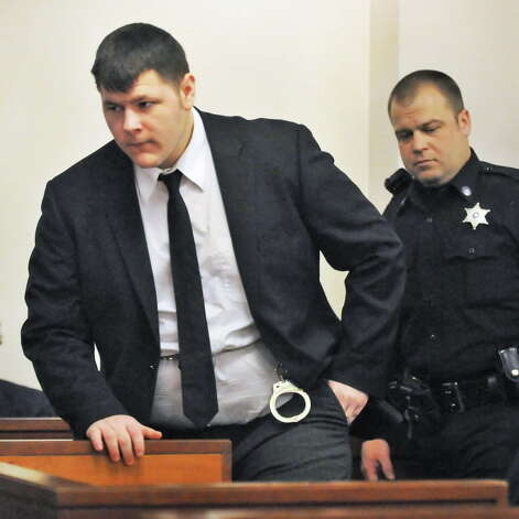 Matthew Slocum arrives for sentencing at the  Washington County Court in Fort Edward N.Y., Friday March 30, 2012. Slocum was sentenced to 101 years to life in prison for killing his mother, stepfather and stepbrother inside their White Creek home last summer and setting the house on fire. (John Carl D'Annibale / Times Union) Photo: John Carl D'Annibale / 00016964A