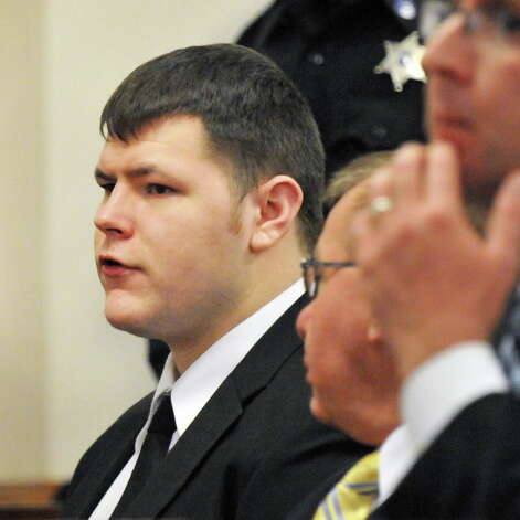 Matthew Slocum, left, is sentenced at the Washington County Court in Fort Edward N.Y., Friday March 30, 2012. Slocum was sentenced to 101 years to life in prison for killing his mother, stepfather and stepbrother inside their White Creek home last summer and setting the house on fire. (John Carl D'Annibale / Times Union) Photo: John Carl D'Annibale / 00016964A
