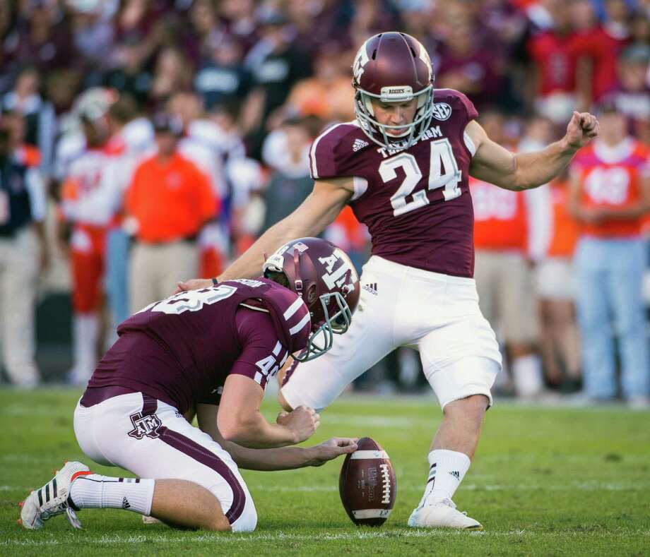 Texas A&M kicker Taylor Bertolet (24) kicks an extra point against Sam Houston State a during the first half of a college football game at Kyle Field, Saturday, Nov. 17, 2012, in College Station. ( Smiley N. Pool / Houston Chronicle ) Photo: Smiley N. Pool, Staff / © 2012  Houston Chronicle