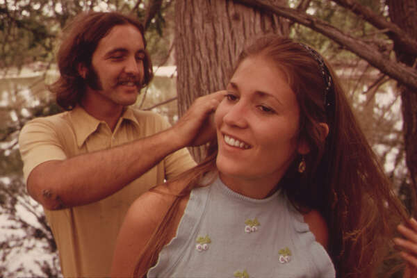 Young Man Picks Leaves from His Girl's Hair after They Had Embraced on the Banks of the Frio Canyon River near Leakey, Texas and San Antonio 05/1973