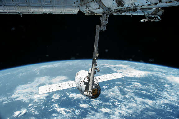The SpaceX Dragon capsule on a resupply mission to the International Space Station. A Baylor College of Medicine researchers was able to test expired medications brought back on the capsule to see if they degraded faster in space.
