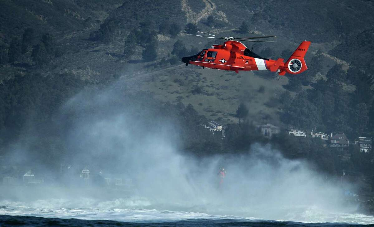Members of the United States Coast Guard practice rescue maneuvers off the Mavericks, Wednesday Feb. 6, 2013, in Half Moon Bay, Calif. These rescues are done once a month to perfect their skills in rogue waves which have killed at least a half dozen people in Northern California.