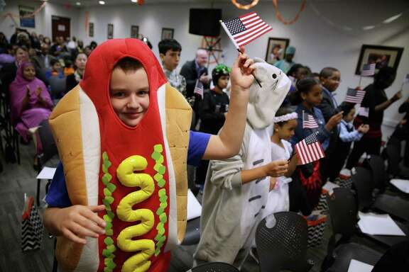 Is this kid dressed as a sandwich? No. He's a hot dog.
