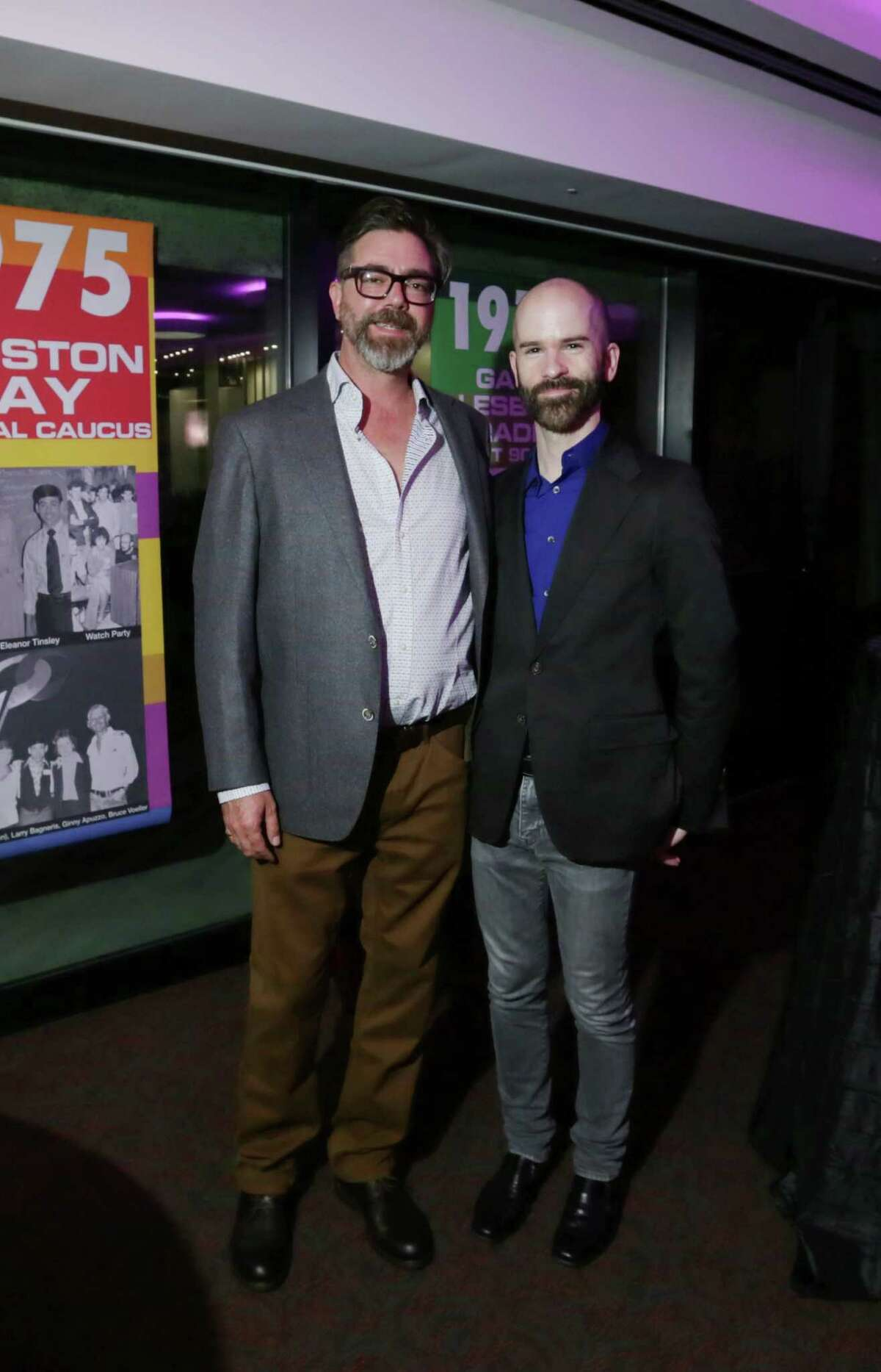"""People pose for a photo at a preview party for the documentary """"The Trouble With Ray,"""" at the Alley Theatre, Wednesday, Nov. 11, 2015, in Houston."""