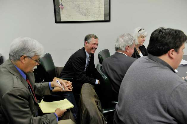 Bethlehem Supervisor John Clarkson, center, is all smiles as it becomes  clear that he has won reelection during a count of absentee ballots at the Albany County Board of Elections on Thursday, Nov. 12, 2015, in Albany, N.Y.    (Paul Buckowski / Times Union)