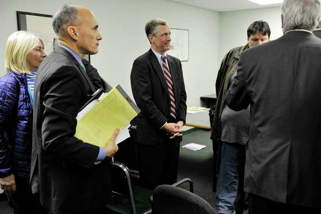 Bethlehem Supervisor John Clarkson, center, gets set to leave the Albany County Board of Elections after winning reelection during a count of absentee ballots on Thursday, Nov. 12, 2015, in Albany, N.Y.    (Paul Buckowski / Times Union)