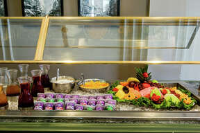 Guests enjoy complimentary a hot breakfast buffet, which includes scrambled eggs, plenty of fresh fruits, sausage and the hotel's famous Texas-shaped waffles.   CLICK HERE to Book Now!