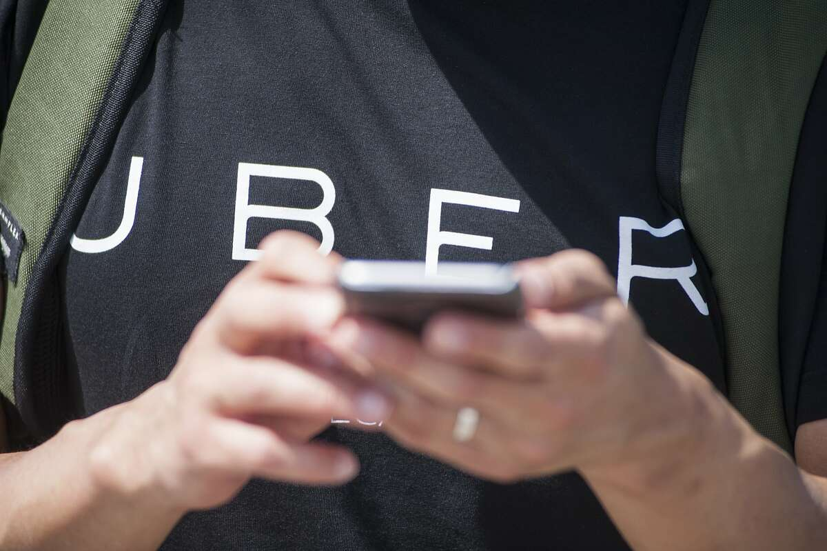 Uber is getting backlash for charging donors a processing fee on Veterans Day donations. (Photo by Martin Ollman/Getty Images)