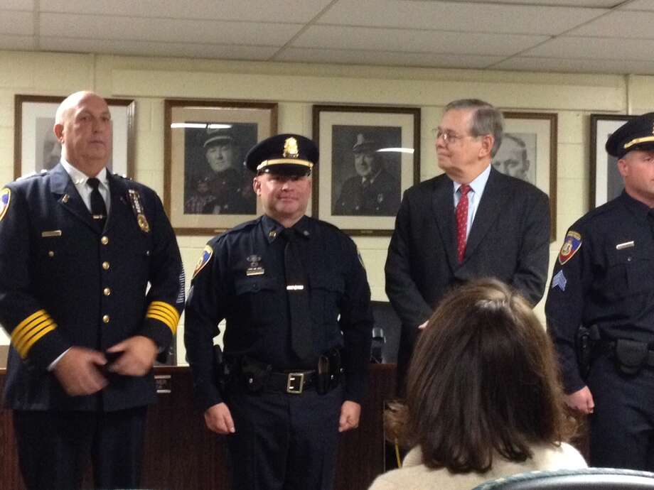 Sgt. Erin Trew flanked by police Chief Jon Fontneau, left, and Mayor David Martin. Photo: John Nickerson / Hearst Connecticut Media / Stamford Advocate Contributed