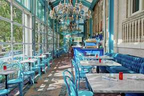 Hotel Havana's restaurant Ocho offers outdoor seating and almost-outdoor seating when its expansive windows open in the indoor dining area.
