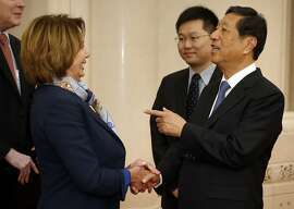 U.S. House Minority Leader Nancy Pelosi of Calif., left, speaks with with Zhang Ping, vice chairman of China's National People's Congress, as she arrives for a bilateral meeting at the Great Hall of the People in Beijing, Thursday, Nov. 12, 2015. (AP Photo/Mark Schiefelbein, Pool)