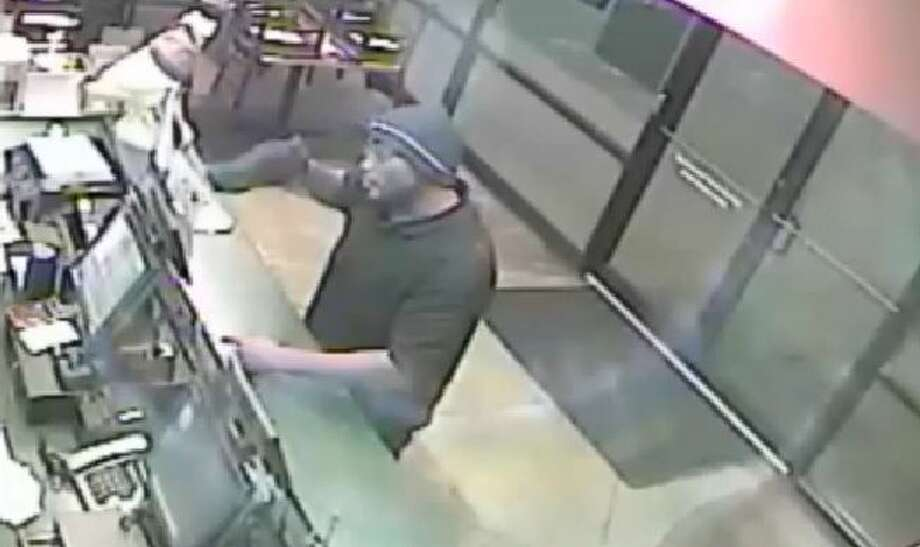 Houston police are asking for the public's help in identifying a suspect wanted in up to 30 fast-food restaurant robberies in Harris and Fort Bend counties. He's about 6-2 and weighs about 250 to 275 pounds. Photo: Christian, Carol, Screen Shots Of Surveillance Video Via Houston Police Department