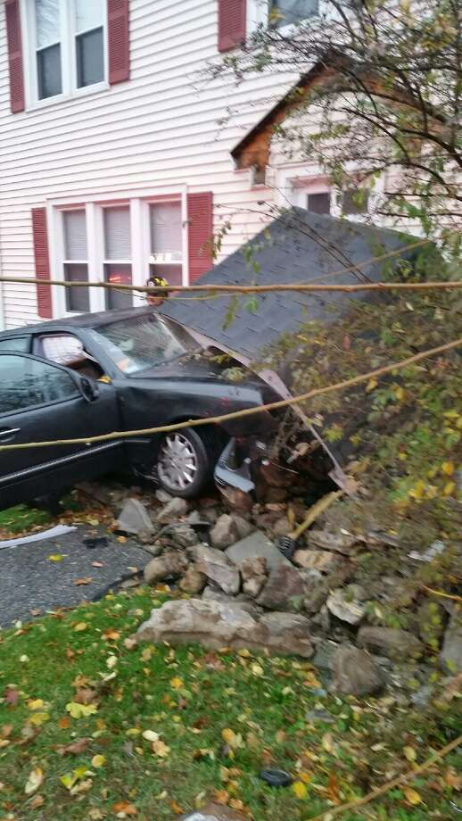 A car drove into a home on High Ridge Road about 8 a.m. Thursday. The driver was in critical condition following the crash. Photo: Contributed Photo / Stamford Police / Stamford Advocate Contributed