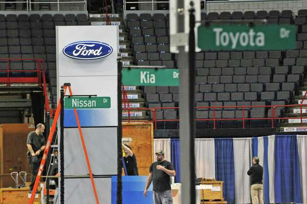 Preparation work for the Albany Auto Show at the Times Union Center on Thursday Nov.12, 2015 in Albany, N.Y. The show at the Times Union Center runs Nov. 13-15. (Michael P. Farrell/Times Union) Photo: Michael P. Farrell / 00034049A