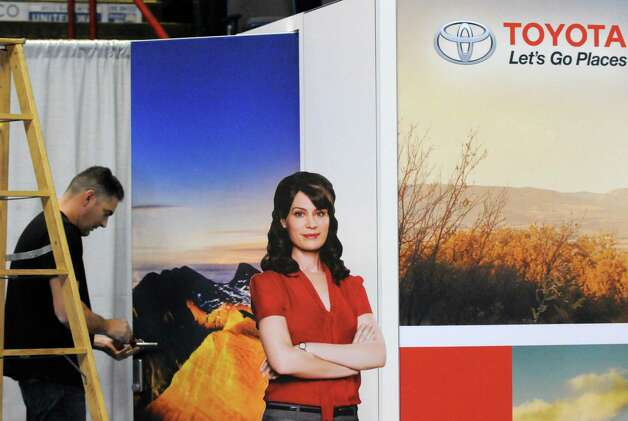 Set up supervisor Jamie Mariarty works on the Toyota booth in preparation for the Albany Auto Show at the Times Union Center on Thursday Nov.12, 2015 in Albany, N.Y. The show at the Times Union Center runs Nov. 13-15. (Michael P. Farrell/Times Union) Photo: Michael P. Farrell / 00034049A