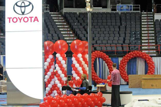 Chris Potts, center, and Stephanie Swald with Balloon Masters work on a balloon display for the Toyota booth in preparation for the Albany Auto Show at the Times Union Center on Thursday Nov.12, 2015 in Albany, N.Y. The show at the Times Union Center runs Nov. 13-15. (Michael P. Farrell/Times Union) Photo: Michael P. Farrell / 00034049A
