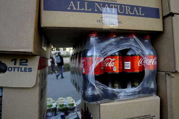 A cart full of beverages and snacks includes coke products, as they are being moved across campus to restock a nearby vending machine at San Francisco State University in San Francisco, Calif. on Thurs. November 12, 2015. Students and faculty are fighting the school's president's Òpouring contractÓ which would give Coke or Pepsi the exclusive rights to sell drinks on campus,