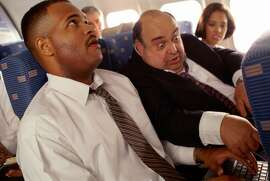 AIRPLANE TRAVEL, MAN ANNOYING PASSENGER