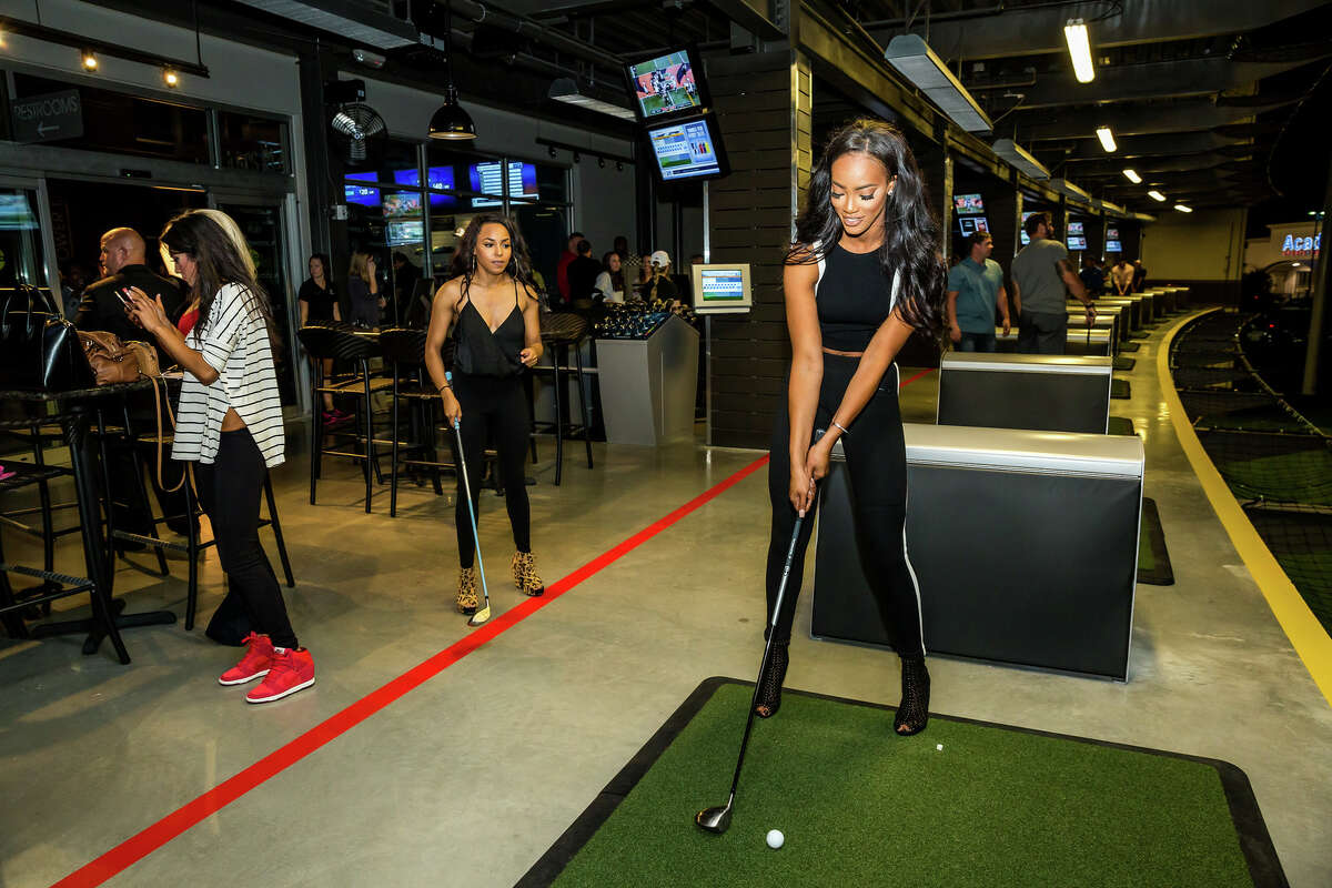 Guests check out the new Topgolf facilities in Webster during a VIP party on Nov. 5.