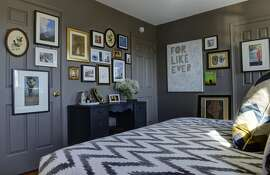 Kerra Michele Huerta and her tiny apartment on October, 25, 2013 in Washington, DC. Pictured, the bedroom, with a neutral paint covering walls, trim and doors. (Photo by Bill O'Leary/The Washington Post via Getty Images)