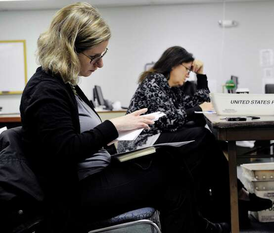Ellen Roach, left, unofficial second place finisher for school board, and Sue Adler, vice president of the Albany School Board, look over the envelopes containing absentee ballots during the count of absentee ballots for the Albany High School referendum at the Albany County Board of Elections on Thursday, Nov. 12, 2015, in Albany, N.Y.  Roach ran opposing the referendum.     (Paul Buckowski / Times Union) Photo: PAUL BUCKOWSKI / 00034220A