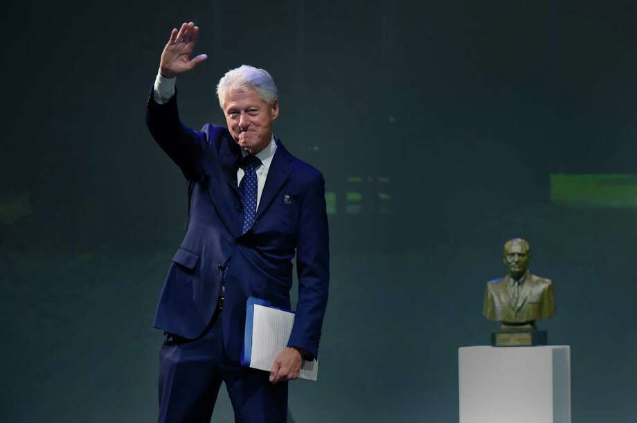 Former President Bill Clinton, seen here at the University of Connecticut in October, will come to Greenwich on Monday for a private, closed event at Temple Sholom. (Cloe Poisson/Hartford Courant via AP) Photo: Cloe Poisson / Associated Press / Hartford Courant