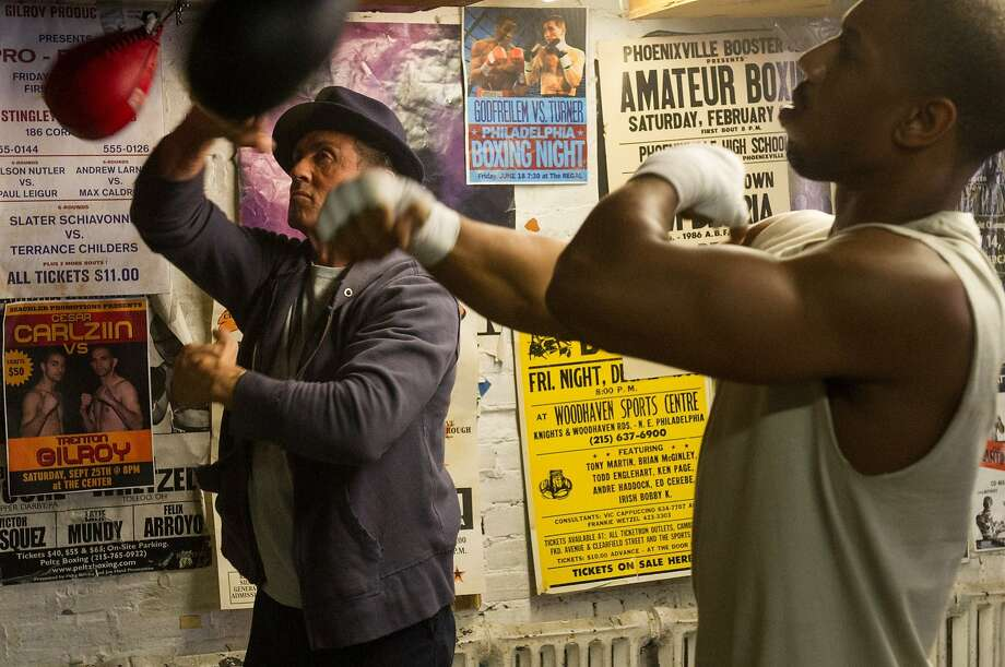 "Rocky Balboa (Sylvester Stallone, left) trains Adonis Johnson (Michael B. Jordan) in ""Creed."" Photo: Warner Bros."