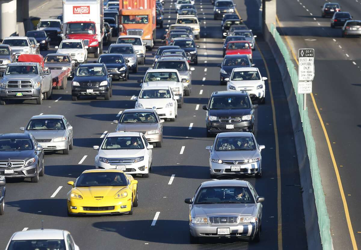 Commuters drive in the carpool lane (at right) on westbound Interstate 80 towards the MacArthur Maze and Bay Bridge in Berkeley, Calif. on Thursday, Nov. 12, 2015. Click through the slideshow to find out which cities have the worst traffic.