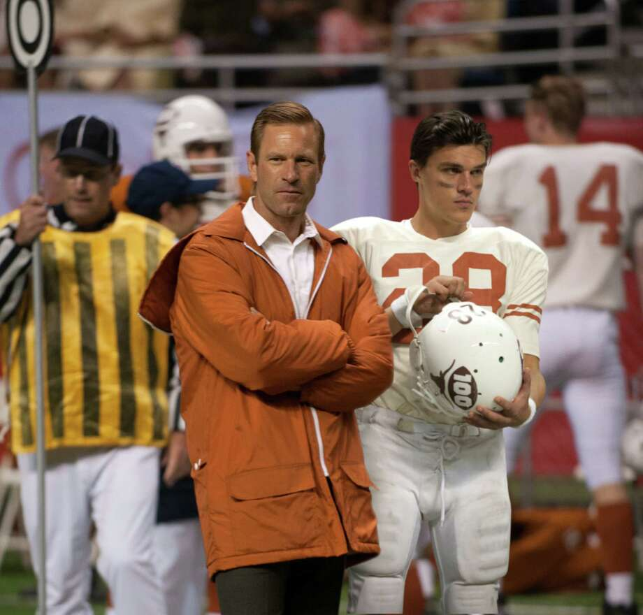 "University of Texas coach Darrell Royal (Aaron Eckhart) and star safety Freddie Steinmark (Finn Wittrock, right) observe from the sidelines in ""My All-American."" Photo: Van Redin"