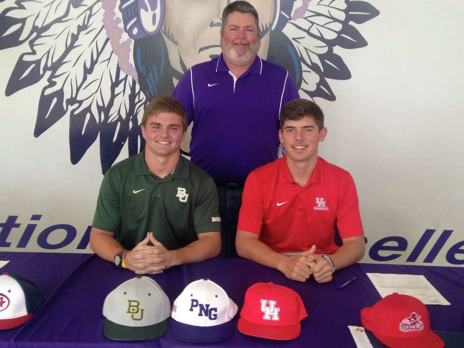 PN-G's top two pitchers Ryan Leckich, left, and Carter Henry, right, both signed National Letters of Intent to play baseball Thursday. Accompanied by Indians coach Scott Carter, Leckich signed with Baylor and Henry signed with Houston.