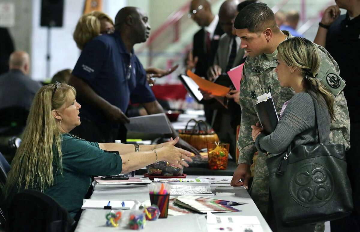 U.S. Army David Torres and his wife, Dennise Diaz, talk with Sherilyn Leone of Respite Care of San Antonio at a Texas Workforce Commission job fair. San Antonio logged 3.6 percent job growth in 2014 and 2015, said Keith Phillips, assistant vice president and senior economist for the San Antonio branch of the Dallas Fed.