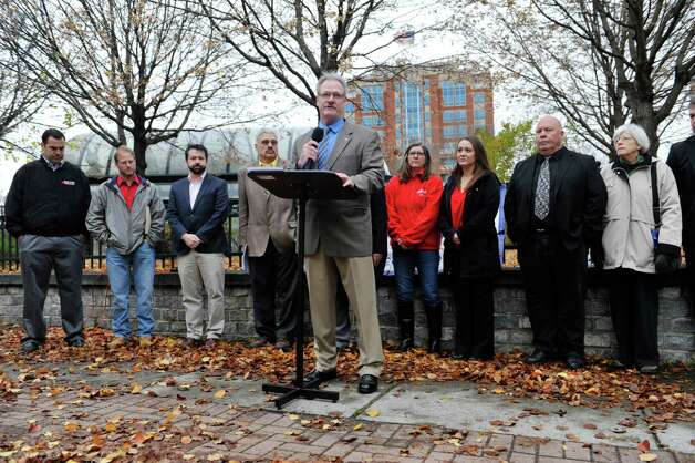 Frank Natalie, executive vice president of the Capital District Area Labor Federation, surrounded by representatives from organized labor, community and faith groups addresses those gathered for a press conference on Thursday, Nov. 12, 2015, in Albany, N.Y.  The groups held the press event to voice their opposition to the Trans-Pacific Partnership.      (Paul Buckowski / Times Union) Photo: PAUL BUCKOWSKI / 00034190A