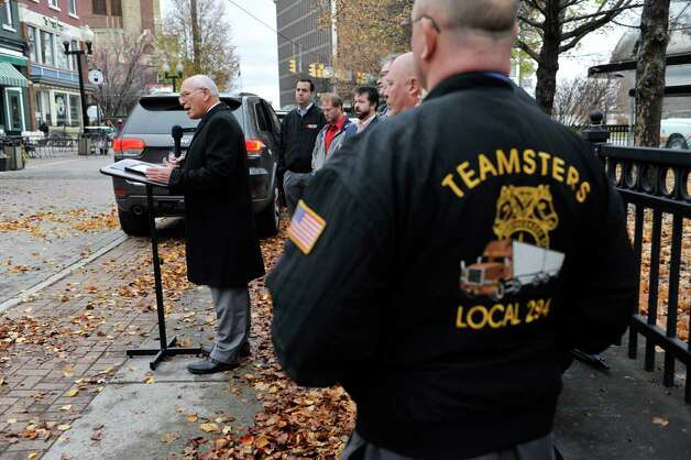 Congressman Paul Tonko, left, along with representatives from organized labor, community and faith groups take part in a press conference to voice their opposition to the Trans-Pacific Partnership on Thursday, Nov. 12, 2015, in Albany, N.Y.    (Paul Buckowski / Times Union) Photo: PAUL BUCKOWSKI / 00034190A