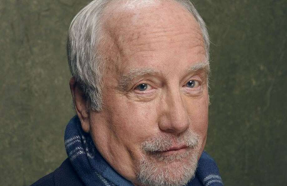 A former co-worker of Richard Dreyfuss' has accused the actor of exposing himself to her in the 1980s, which Dreyfuss denies.