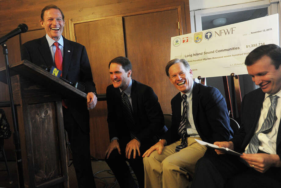 From left; U.S. Sen. Richard Blumenthal cracks a joke that has U.S. Rep. Jim Himes, Audubon CT Executive Director Stuart Hudson and U.S. Sen. Chris Murphy laughing during the announcement of the Long Island Sound Futures Fund's 2015 grant awards at Stratford Point in Stratford on Nov. 12. Photo: Brian A. Pounds / Hearst Connecticut Media / Connecticut Post