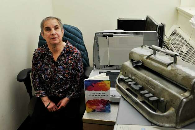 Sally Friedman, an associate professor of political science at the University at Albany poses for a photograph in her office on Wednesday, Nov. 11, 2015, in Albany, N.Y.  Friedman is the author of the book, 52 Quotes to Color Your Weeks.  In the photograph is a braille machine, upper right, which Friedman uses to write in braille.  (Paul Buckowski / Times Union) Photo: PAUL BUCKOWSKI / 00034197A