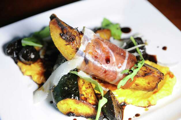 Acorn Squash Wedge with prosciutto, buttered squash puree, balsamic fig, Saba, shaved pecorino and arugula on Friday, Nov. 6, 2015, at Campagna in Malta, N.Y. (Cindy Schultz / Times Union) Photo: Cindy Schultz / 00034094A