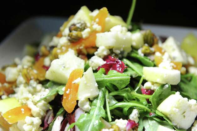 Campagna Insalata with arugula, radicchio, fresh apple, dried apricot, gorgonzola dolce, pistachio and white balsamic vinaigrette on Friday, Nov. 6, 2015, at Campagna in Malta, N.Y. (Cindy Schultz / Times Union) Photo: Cindy Schultz / 00034094A