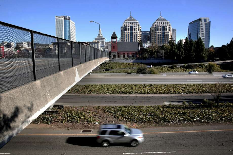 Interstate 980 passes under 12th Street in Oakland. Some say it's time for the divisive motorway to go. Photo: Michael Macor, The Chronicle
