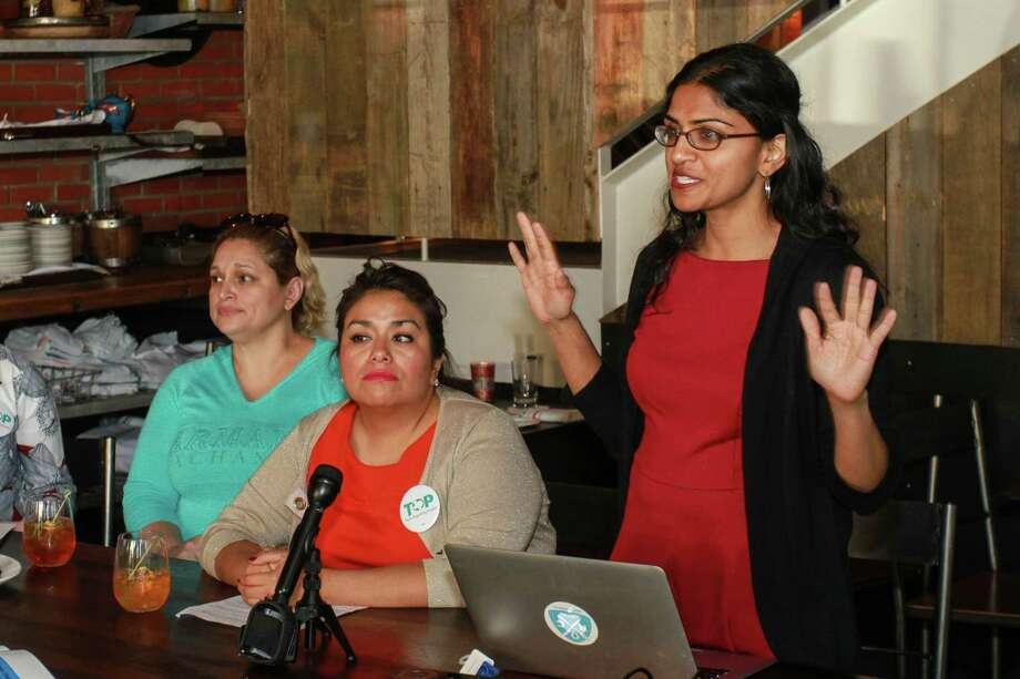 Saru Jayaraman, right, co-founder of Restaurant Opportunities Center United, speaks Thursday about her group's study about working conditions. With her are Mirella Nava, left, and Mary Moreno. , Photo: Gary Fountain, For The Chronicle / Copyright 2015 Gary Fountain