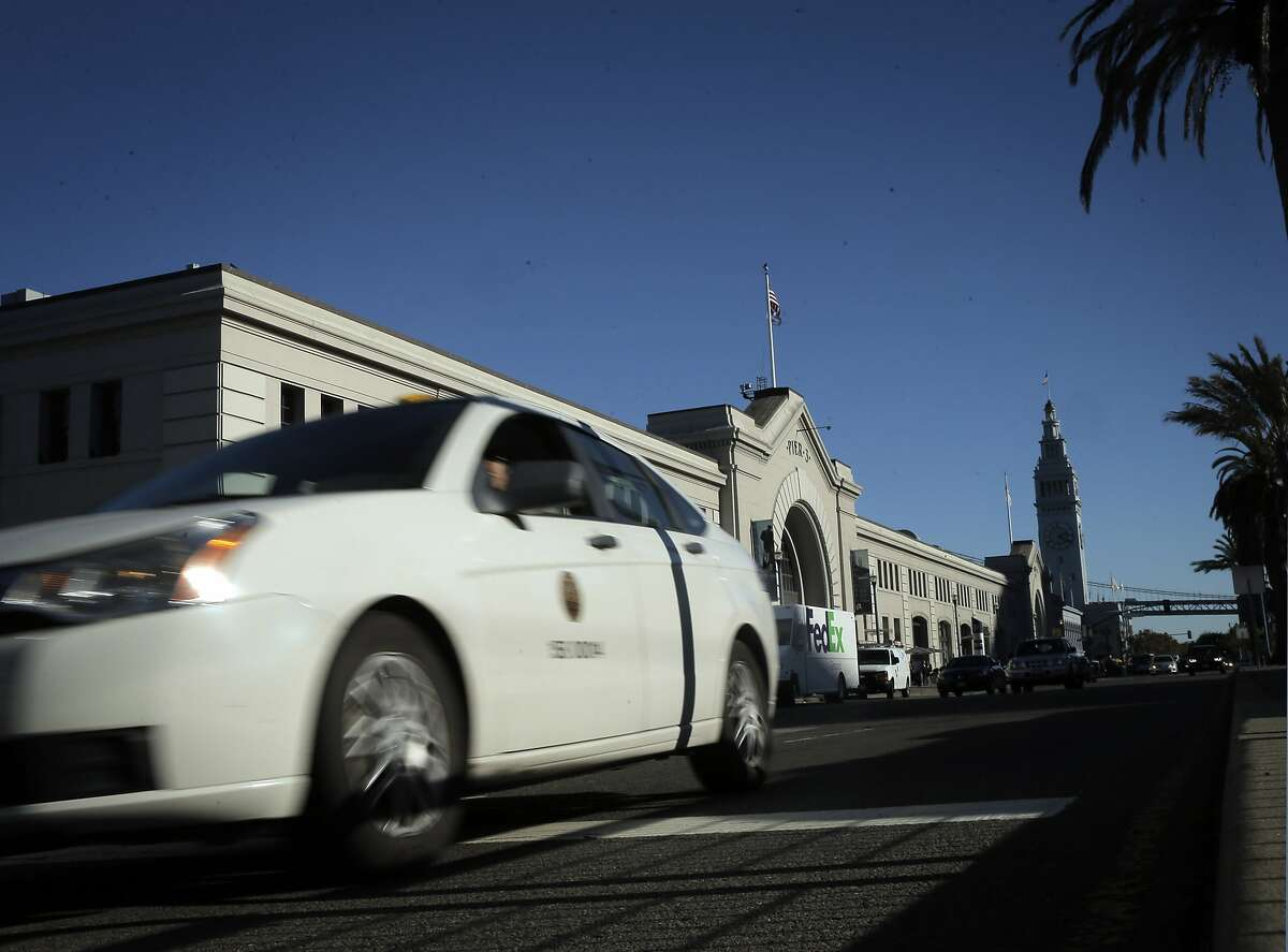 Drivers course along the Embarcadero in San Francisco, Calif., on Thursday, November 12, 2015. The city of San Francisco is considering installing new speed cameras on several major thoroughfares.