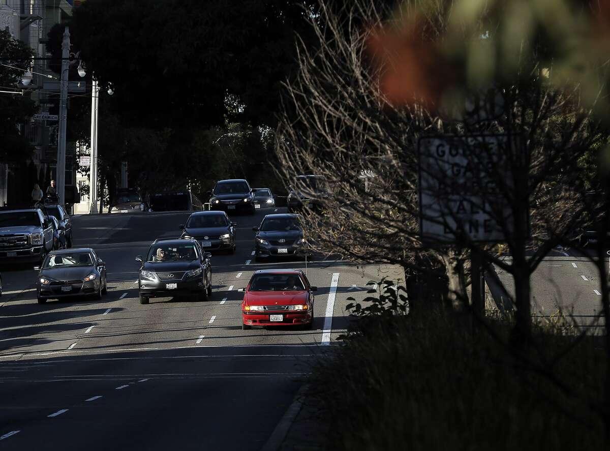 Drivers make their way along Van Ness Avenue in San Francisco, Calif., on Thursday, November 12, 2015.