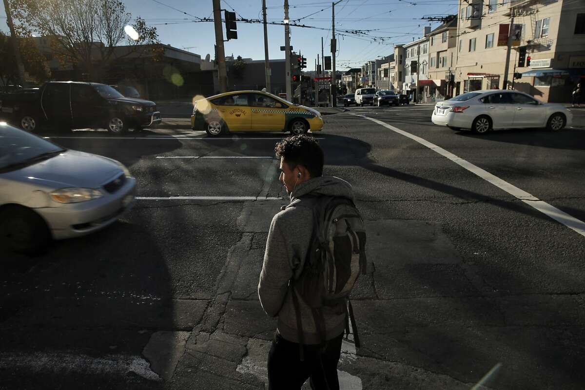 Victor Sanchez waits to cross Van Ness Avenue as drivers make their way along the major traffic artery in San Francisco, Calif., on Thursday, November 12, 2015. The city of San Francisco is considering installing new speed cameras on several major thoroughfares.