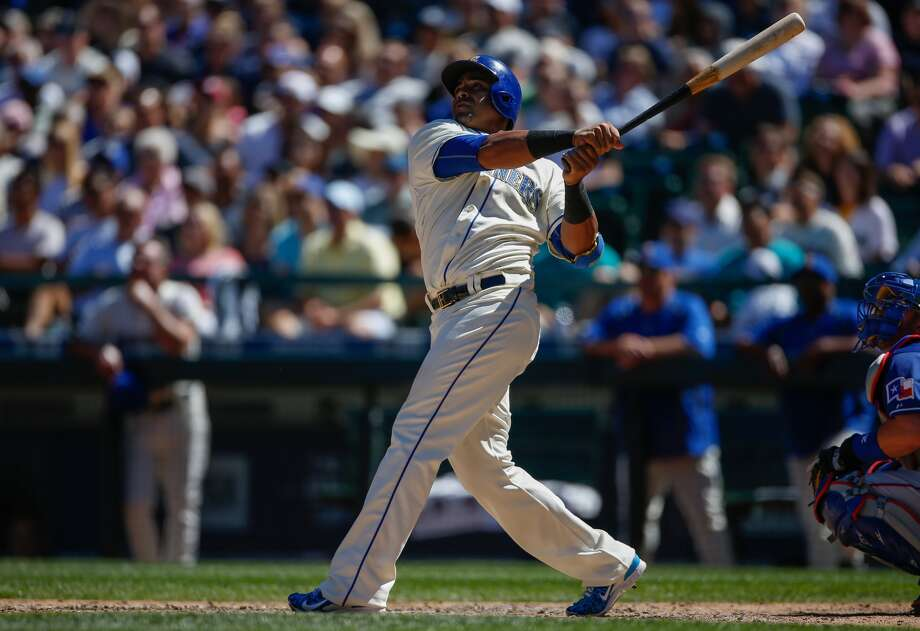 Nelson Cruz of the Seattle Mariners hits a solo home run in the sixth inning against the Texas Rangers at Safeco Field on August 9, 2015 in Seattle, Washington. (Photo by Otto Greule Jr/Getty Images)