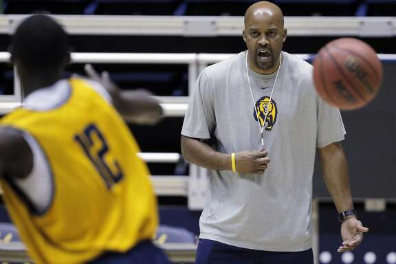 Basketball coach Cuonzo Martin instructs one of his players doing drils during the Cal men's basketball practice at Haas Pavilion in Berkeley, Calif., on Tuesday, November 11, 2014.