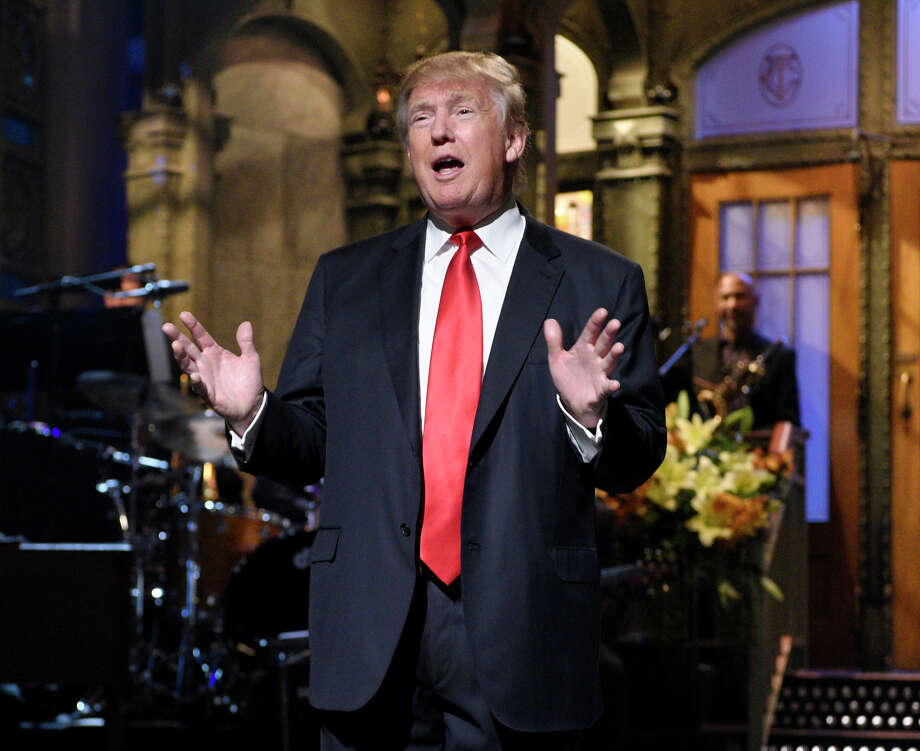 "Republican presidential candidate Donald Trump speaks during the monologue as he guest hosts on ""Saturday Night Live."" The show averaged 9.3 million viewers, according to final Nielsen figures released Thursday, Nov. 12.  (Dana Edelson/NBC via AP) Photo: Dana Edelson, HONS / NBC"