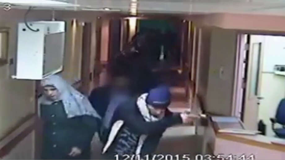 A video released by Al-Ahli Hospital shows an arrest raid Thursday in Hebron in which Israeli forces, with one officer disguised as a pregnant Muslim woman and others disguised in fake beards, dragged out a Palestinian stabbing suspect. Photo: HONS / AP