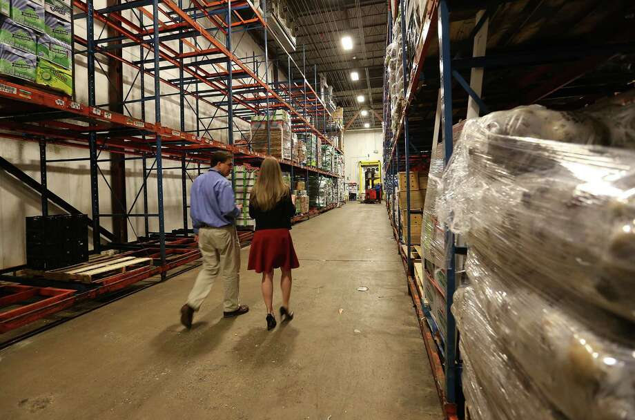 Brian Green, president and CEO of the Houston Food Bank, gives a tour of the facility to former first daughter Chelsea Clinton on Thursday, Oct. 15, 2015.   ( Elizabeth Conley / Houston Chronicle ) Photo: Elizabeth Conley, Staff / © 2015 Houston Chronicle