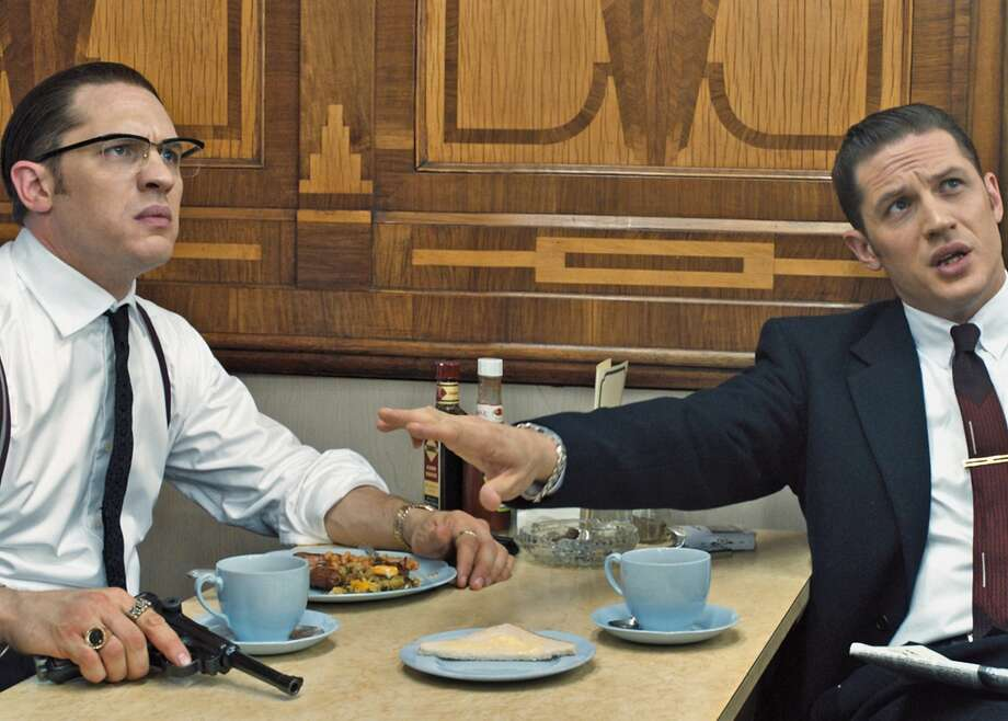 """In the film """"Legend,"""" Ronnie Kray (Tom Hardy) is a bit of a loose cannon. Fortunately, brother Reggie Kray (Tom Hardy) is there to keep him tethered ... until they fight each other in a stunt scene. Photo: Universal Pictures"""